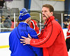 Baldwinsville Bees Assistant Coach Glenn McCaffrey shaking hands with a West Genesee Wildcats coach in NYSPHSAA Section III Boys Ice hockey playoff action at Shove Park in Camillus, New York on Wednesday, February 21, 2018. Baldwinsville won 2-1 in a Shootout.