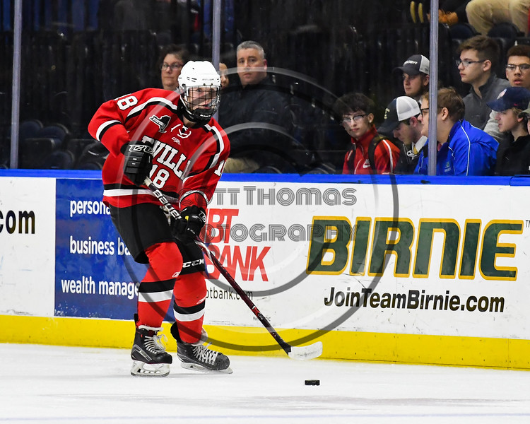 Baldwinsville Bees Brendan Wilcox (18) passes the puck against the Syracuse Cougars in the NYSPHSAA Section III Division I Boys Ice hockey Championship game at the War Memorial Arena in Syracuse, New York on Monday, February 26, 2018. Syracuse won 4-2.