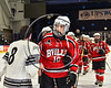 Baldwinsville Bees Brett Sabourin (10) shakes hands with Syracuse Cougars players after the NYSPHSAA Section III Division I Boys Ice hockey Championship game at the War Memorial Arena in Syracuse, New York on Monday, February 26, 2018. Syracuse won 4-2.