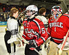 Baldwinsville Bees Anthony Pompo (55) and goalie Josh Smith (1) shakes hands with Syracuse Cougars players after the NYSPHSAA Section III Division I Boys Ice hockey Championship game at the War Memorial Arena in Syracuse, New York on Monday, February 26, 2018. Syracuse won 4-2.