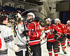 Baldwinsville Bees Isaiah Pompo (5) shakes hands with Syracuse Cougars players after the NYSPHSAA Section III Division I Boys Ice hockey Championship game at the War Memorial Arena in Syracuse, New York on Monday, February 26, 2018. Syracuse won 4-2.