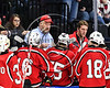 Baldwinsville Bees Head Coach Mark Lloyd talks with this team during a time out against the Syracuse Cougars in the NYSPHSAA Section III Division I Boys Ice hockey Championship game at the War Memorial Arena in Syracuse, New York on Monday, February 26, 2018. Syracuse won 4-2.