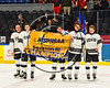 Syracuse Cougars Ryan Eccles (23), Bryan O'Mara (22), Philip Zollo (8), Hugh White (9) and Nate Frye (4) with the NYSPHSAA Section III Division I Boys Ice Hockey Championship banner at the War Memorial Arena in Syracuse, New York on Monday, February 26, 2018 after defeating Baldwinsville, 4-2.
