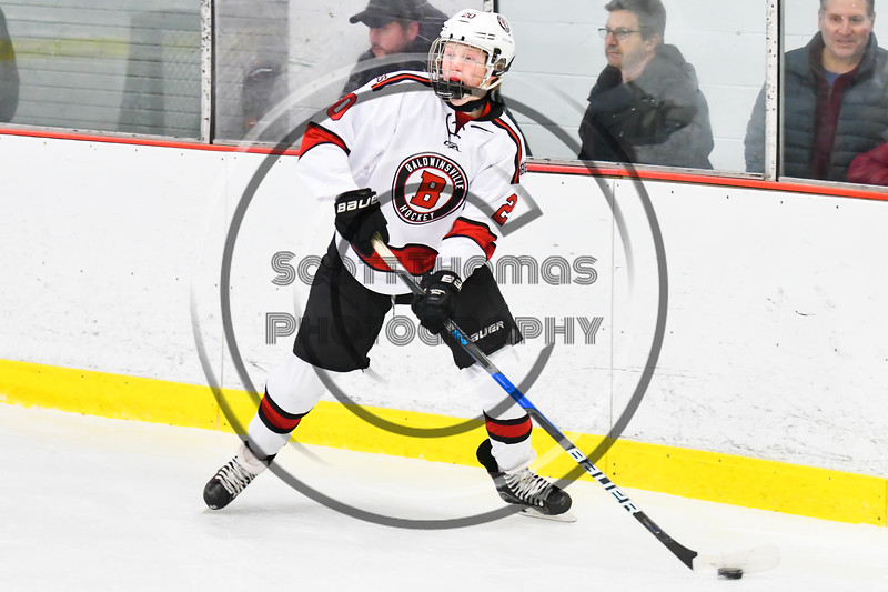 Baldwinsville Bees Casey Scott (20) looking to make a play against the Liverpool Warriors in NYSPHSAA Section III Boys Ice Hockey action at the Lysander Ice Arena in Baldwinsville, New York on Thursday, December 6, 2018. Baldwinsville won 5-2.