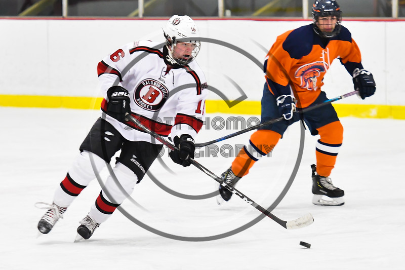 Baldwinsville Bees Luke Hoskin (16) skating with the puck against the Liverpool Warriors in NYSPHSAA Section III Boys Ice Hockey action at the Lysander Ice Arena in Baldwinsville, New York on Thursday, December 6, 2018. Baldwinsville won 5-2.