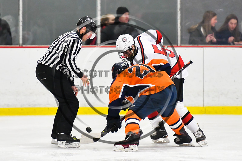 Baldwinsville Bees Alexander Pompo (5) facing off against Liverpool Warriors Pat Langlois (21) in NYSPHSAA Section III Boys Ice Hockey action at the Lysander Ice Arena in Baldwinsville, New York on Thursday, December 6, 2018. Baldwinsville won 5-2.