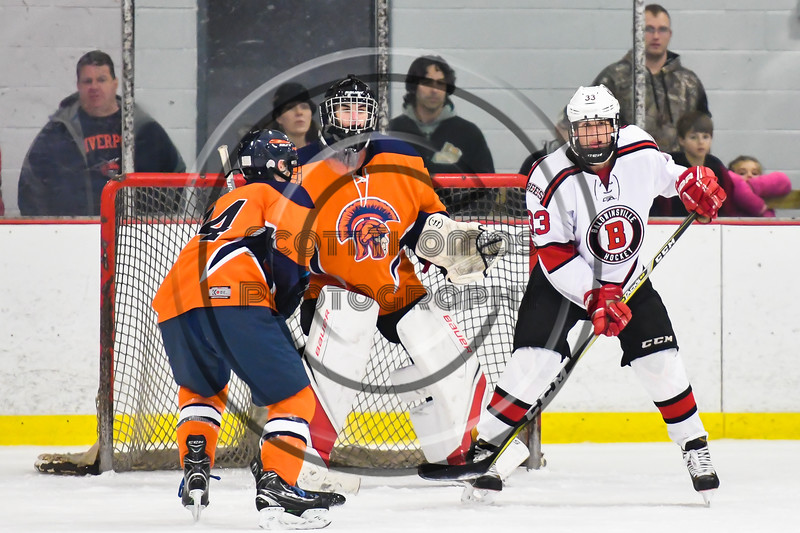Baldwinsville Bees Christian Treichler (33) battles for the position in front of Liverpool Warriors goalie Gavin Buza (35) in NYSPHSAA Section III Boys Ice Hockey action at the Lysander Ice Arena in Baldwinsville, New York on Thursday, December 6, 2018. Baldwinsville won 5-2.
