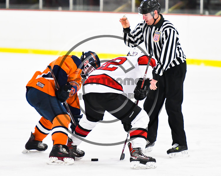 Baldwinsville Bees Mark Monaco (22) facing off against a Liverpool Warriors player in NYSPHSAA Section III Boys Ice Hockey action at the Lysander Ice Arena in Baldwinsville, New York on Thursday, December 6, 2018. Baldwinsville won 5-2.