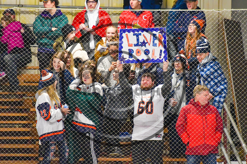 Liverpool Warriors fans rooting on their team in a NYSPHSAA Section III Boys Ice Hockey game against the Baldwinsville Bees at the Lysander Ice Arena in Baldwinsville, New York on Thursday, December 6, 2018. Baldwinsville won 5-2.