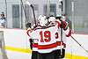 Baldwinsville Bees congratulated Braden Lynch (23) on his goal against the Liverpool Warriors in NYSPHSAA Section III Boys Ice Hockey action at the Lysander Ice Arena in Baldwinsville, New York on Thursday, December 6, 2018. Baldwinsville won 5-2.
