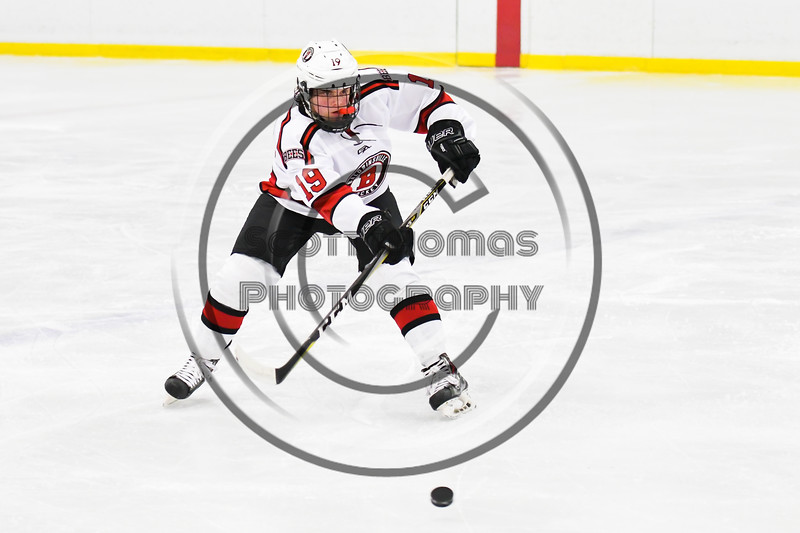 Baldwinsville Bees Michael Marsallo (19) passes the puck against the Liverpool Warriors in NYSPHSAA Section III Boys Ice Hockey action at the Lysander Ice Arena in Baldwinsville, New York on Thursday, December 6, 2018. Baldwinsville won 5-2.