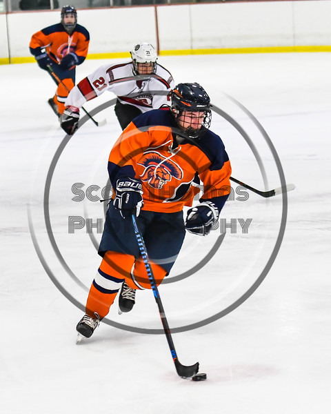 Liverpool Warriors Connor Boland (22) skating with the puck against the Baldwinsville Bees in NYSPHSAA Section III Boys Ice Hockey action at the Lysander Ice Arena in Baldwinsville, New York on Thursday, December 6, 2018. Baldwinsville won 5-2.