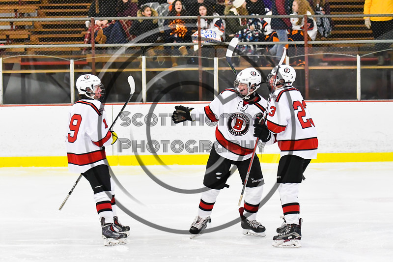Baldwinsville Bees Luke Hoskin (16) celebrates his goal against the Liverpool Warriors with Michael Marsallo (19) and Braden Lynch (23) in NYSPHSAA Section III Boys Ice Hockey action at the Lysander Ice Arena in Baldwinsville, New York on Thursday, December 6, 2018. Baldwinsville won 5-2.