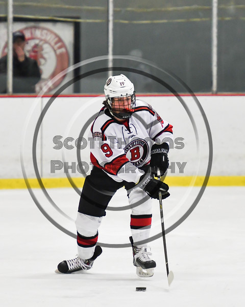 Baldwinsville Bees Matt Carner (9) with the puck against the Liverpool Warriors in NYSPHSAA Section III Boys Ice Hockey action at the Lysander Ice Arena in Baldwinsville, New York on Thursday, December 6, 2018. Baldwinsville won 5-2.
