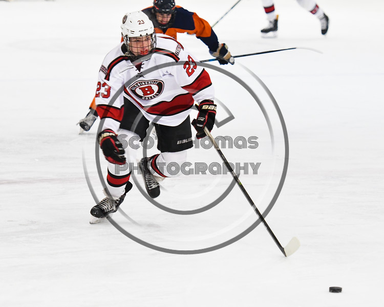 Baldwinsville Bees Braden Lynch (23) skating with the puck against the Liverpool Warriors in NYSPHSAA Section III Boys Ice Hockey action at the Lysander Ice Arena in Baldwinsville, New York on Thursday, December 6, 2018. Baldwinsville won 5-2.