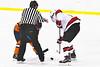 Baldwinsville Bees Cameron Sweeney (21) faces off against a Liverpool Warriors player in NYSPHSAA Section III Boys Ice Hockey action at the Lysander Ice Arena in Baldwinsville, New York on Thursday, December 6, 2018. Baldwinsville won 5-2.