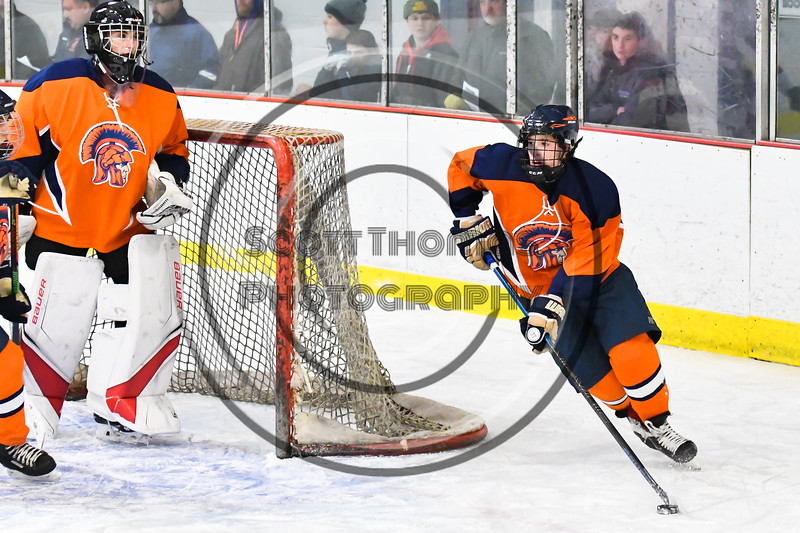 Liverpool Warriors player comes out from behind the net with the puck against the Baldwinsville Bees in NYSPHSAA Section III Boys Ice Hockey action at the Lysander Ice Arena in Baldwinsville, New York on Thursday, December 6, 2018. Baldwinsville won 5-2.