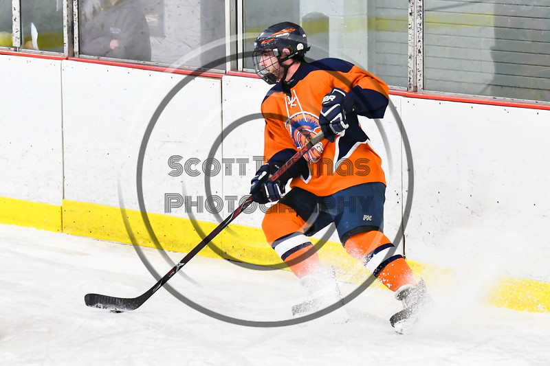 Liverpool Warriors player with the puck against the Baldwinsville Bees in NYSPHSAA Section III Boys Ice Hockey action at the Lysander Ice Arena in Baldwinsville, New York on Thursday, December 6, 2018. Baldwinsville won 5-2.