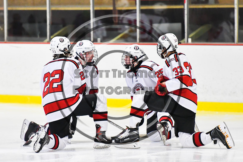 Baldwinsville Bees players Mark Monaco (22), Parker Schroeder (8), Jamey Natoli (25) and Christian Treichler (33) talk before the start of the third period against the Liverpool Warriors in a NYSPHSAA Section III Boys Ice Hockey game at the Lysander Ice Arena in Baldwinsville, New York on Thursday, December 6, 2018. Baldwinsville won 5-2.