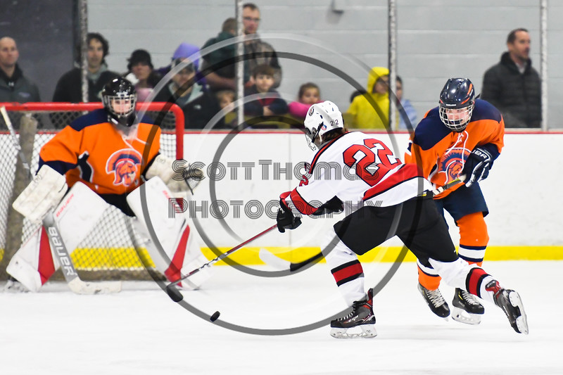 Baldwinsville Bees Mark Monaco (22) skates with the puck against the Liverpool Warriors in NYSPHSAA Section III Boys Ice Hockey action at the Lysander Ice Arena in Baldwinsville, New York on Thursday, December 6, 2018. Baldwinsville won 5-2.