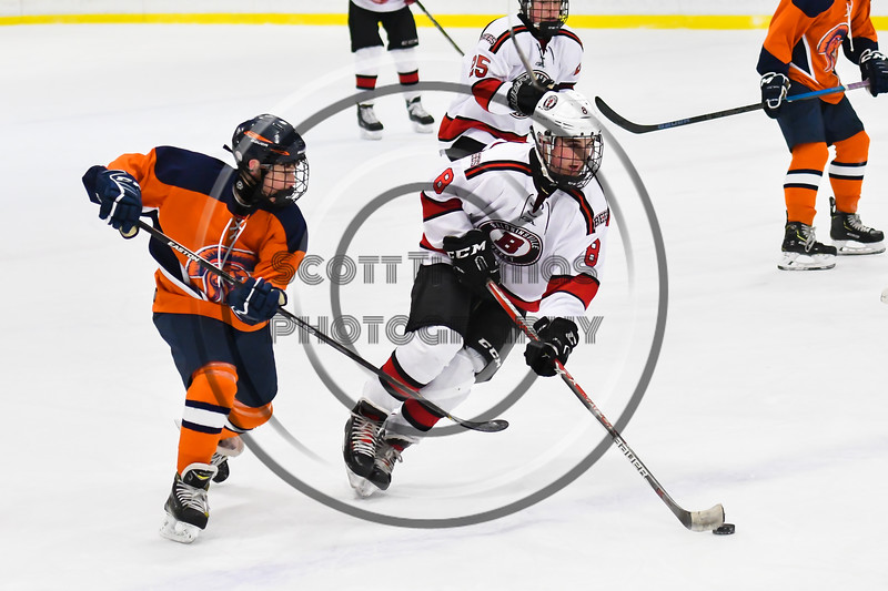 Baldwinsville Bees Parker Schroeder (8) skating with the puck past a Liverpool Warriors defender in NYSPHSAA Section III Boys Ice Hockey action at the Lysander Ice Arena in Baldwinsville, New York on Thursday, December 6, 2018. Baldwinsville won 5-2.