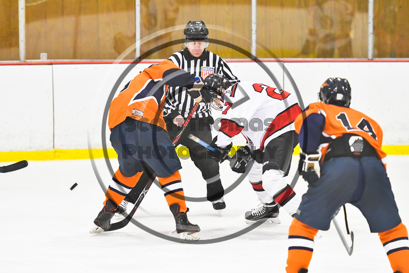 Baldwinsville Bees Tyler Berito (27) faced off against a Liverpool Warriors player in NYSPHSAA Section III Boys Ice Hockey action at the Lysander Ice Arena in Baldwinsville, New York on Thursday, December 6, 2018. Baldwinsville won 5-2.