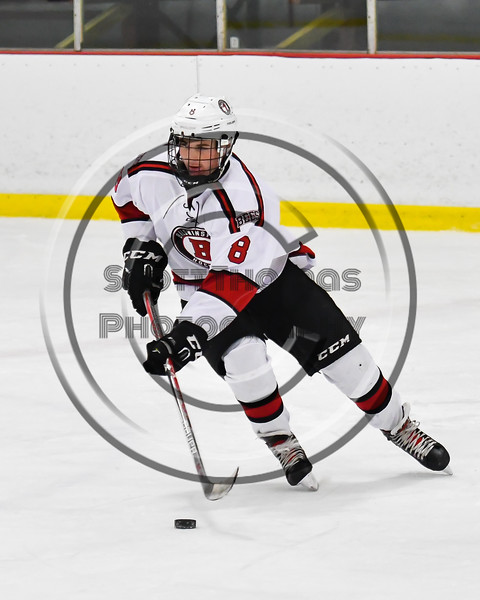 Baldwinsville Bees Parker Schroeder (8) skating with the puck against the Liverpool Warriors in NYSPHSAA Section III Boys Ice Hockey action at the Lysander Ice Arena in Baldwinsville, New York on Thursday, December 6, 2018. Baldwinsville won 5-2.