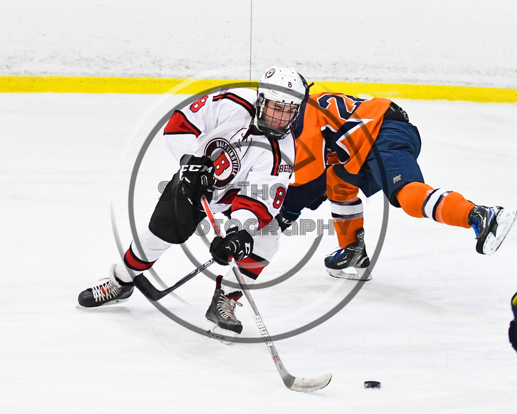 Baldwinsville Bees Parker Schroeder (8) leans into a backhand shot against the Liverpool Warriors in NYSPHSAA Section III Boys Ice Hockey action at the Lysander Ice Arena in Baldwinsville, New York on Thursday, December 6, 2018. Baldwinsville won 5-2.