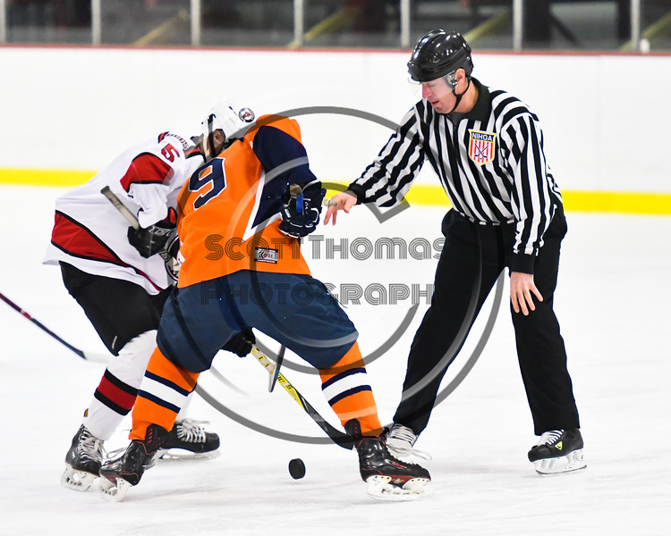 Baldwinsville Bees Alexander Pompo (5) faces off against Liverpool Warriors Matthew Gangnon (9) in NYSPHSAA Section III Boys Ice Hockey action at the Lysander Ice Arena in Baldwinsville, New York on Thursday, December 6, 2018. Baldwinsville won 5-2.