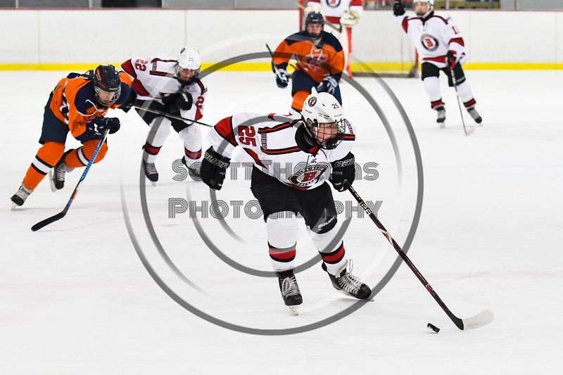Baldwinsville Bees Jamey Natoli (25) skating with the puck against the Liverpool Warriors in NYSPHSAA Section III Boys Ice Hockey action at the Lysander Ice Arena in Baldwinsville, New York on Thursday, December 6, 2018. Baldwinsville won 5-2.