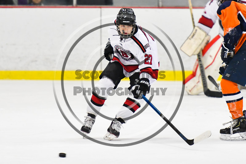 Baldwinsville Bees Tyler Berito (27) tracking the puck against the Liverpool Warriors in NYSPHSAA Section III Boys Ice Hockey action at the Lysander Ice Arena in Baldwinsville, New York on Thursday, December 6, 2018. Baldwinsville won 5-2.