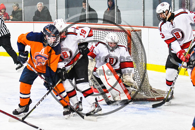 Baldwinsville Bees goalie Tommy Blais (31) makes a stick save against the Liverpool Warriors in NYSPHSAA Section III Boys Ice Hockey action at the Lysander Ice Arena in Baldwinsville, New York on Thursday, December 6, 2018. Baldwinsville won 5-2.