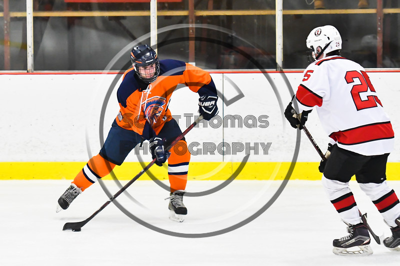 Liverpool Warriors Jack Irwin (20) fires the puck at Baldwinsville Bees net in NYSPHSAA Section III Boys Ice Hockey action at the Lysander Ice Arena in Baldwinsville, New York on Thursday, December 6, 2018. Baldwinsville won 5-2.