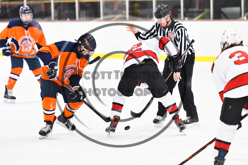 Baldwinsville Bees Mark Monaco (22) faces off against a Liverpool Warriors player in NYSPHSAA Section III Boys Ice Hockey action at the Lysander Ice Arena in Baldwinsville, New York on Thursday, December 6, 2018. Baldwinsville won 5-2.