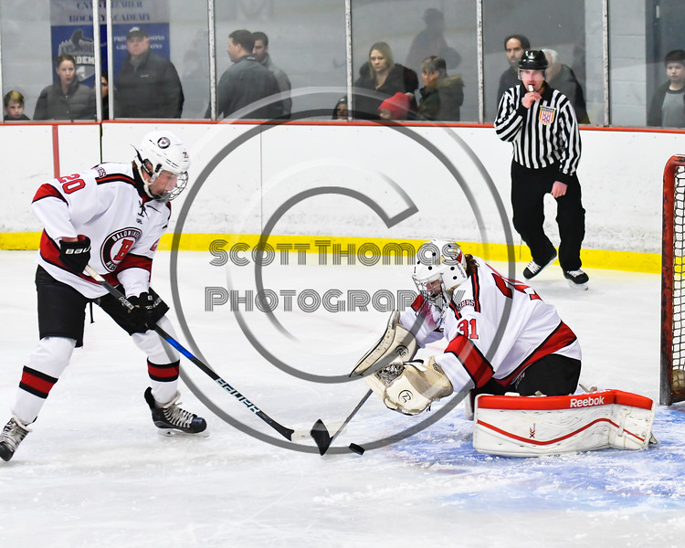 Baldwinsville Bees goalie Tommy Blais (31) pounces on the puck against the Liverpool Warriors in NYSPHSAA Section III Boys Ice Hockey action at the Lysander Ice Arena in Baldwinsville, New York on Thursday, December 6, 2018. Baldwinsville won 5-2.
