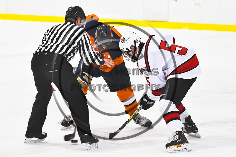 Baldwinsville Bees Alexander Pompo (5) faces off against a Liverpool Warriors net in NYSPHSAA Section III Boys Ice Hockey action at the Lysander Ice Arena in Baldwinsville, New York on Thursday, December 6, 2018. Baldwinsville won 5-2.