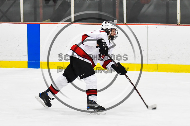 Baldwinsville Bees Ryan Muscatello (3) shooting the puck against the Liverpool Warriors in NYSPHSAA Section III Boys Ice Hockey action at the Lysander Ice Arena in Baldwinsville, New York on Thursday, December 6, 2018. Baldwinsville won 5-2.