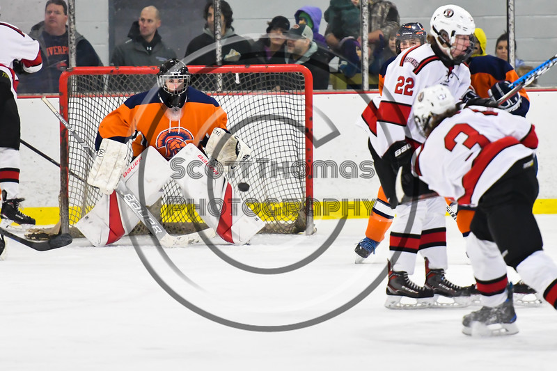 Liverpool Warriors goalie Gavin Buza (35) makes a save against the Baldwinsville Bees in NYSPHSAA Section III Boys Ice Hockey action at the Lysander Ice Arena in Baldwinsville, New York on Thursday, December 6, 2018. Baldwinsville won 5-2.