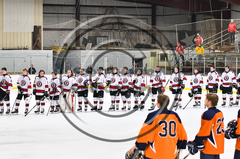 Baldwinsville Bees players during the National Anthem before playing the Liverpool Warriors in a NYSPHSAA Section III Boys Ice Hockey game at the Lysander Ice Arena in Baldwinsville, New York on Thursday, December 6, 2018.