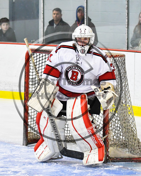 Baldwinsville Bees goalie Tommy Blais (31) in net against the Liverpool Warriors in NYSPHSAA Section III Boys Ice Hockey action at the Lysander Ice Arena in Baldwinsville, New York on Thursday, December 6, 2018. Baldwinsville won 5-2.