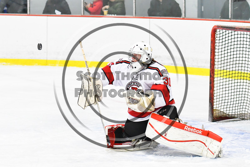 Baldwinsville Bees goalie Tommy Blais (31) makes a save against the Liverpool Warriors in NYSPHSAA Section III Boys Ice Hockey action at the Lysander Ice Arena in Baldwinsville, New York on Thursday, December 6, 2018. Baldwinsville won 5-2.