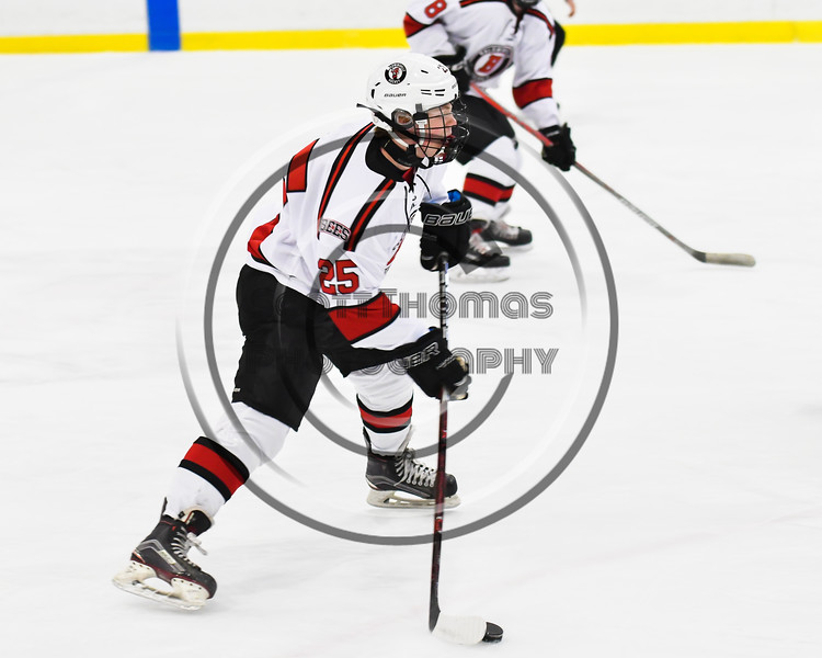 Baldwinsville Bees Jamey Natoli (25) looking to make a play against the Liverpool Warriors in NYSPHSAA Section III Boys Ice Hockey action at the Lysander Ice Arena in Baldwinsville, New York on Thursday, December 6, 2018. Baldwinsville won 5-2.
