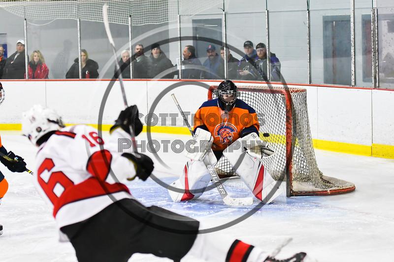 Baldwinsville Bees Luke Hoskin (16) shoots and scores a goal against Liverpool Warriors Gavin Buza (35) in NYSPHSAA Section III Boys Ice Hockey action at the Lysander Ice Arena in Baldwinsville, New York on Thursday, December 6, 2018. Baldwinsville won 5-2.