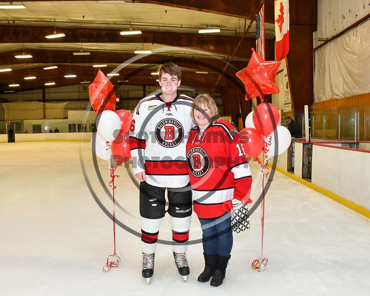 Baldwinsville Bees Luke Hoskin (16) honors Mrs. Southard on Teacher Appreciation Night at the Lysander Ice Arena in Baldwinsville, New York on Tuesday, December 18, 2018.