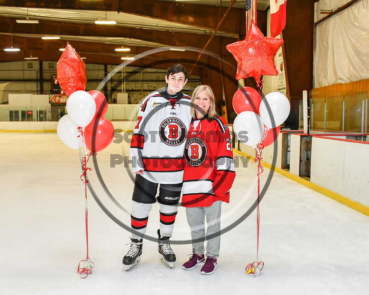 Baldwinsville Bees Tyler DeRito (27)  honors Mrs. Sweeney on Teacher Appreciation Night at the Lysander Ice Arena in Baldwinsville, New York on Tuesday, December 18, 2018.