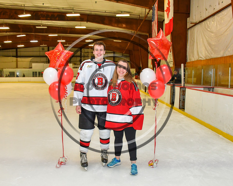 Baldwinsville Bees Ryan Gillespie (7) honors Mrs. Diccoco on Teacher Appreciation Night at the Lysander Ice Arena in Baldwinsville, New York on Tuesday, December 18, 2018.