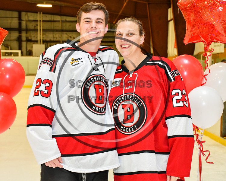 Baldwinsville Bees Braden Lynch (23) honors Mrs. Meany on Teacher Appreciation Night at the Lysander Ice Arena in Baldwinsville, New York on Tuesday, December 18, 2018.