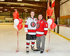 Baldwinsville Bees Parker Schroeder (8) honors Mr. Fortais on Teacher Appreciation Night at the Lysander Ice Arena in Baldwinsville, New York on Tuesday, December 18, 2018.