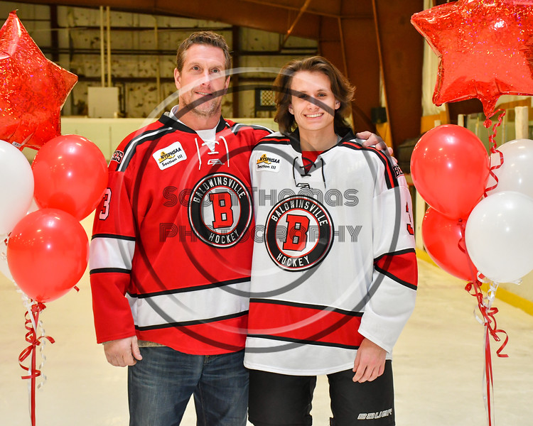 Baldwinsville Bees Ryan Muscatello (3) honors Mr. McCaffrey on Teacher Appreciation Night at the Lysander Ice Arena in Baldwinsville, New York on Tuesday, December 18, 2018.