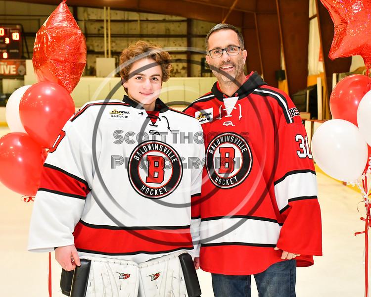 Baldwinsville Bees goalie Bradley O'Neill (30) honors Mr. Scuderi on Teacher Appreciation Night at the Lysander Ice Arena in Baldwinsville, New York on Tuesday, December 18, 2018.